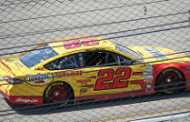 Logano spins to win