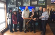 Bank Cuts Ribbon On New Branch Office