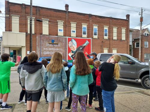 Local Students Tour Murals In Butler